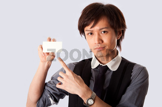 Asian business man pointing at white card