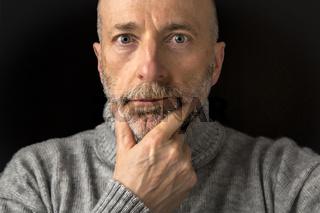 headshot of confident elder man