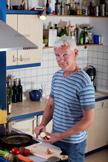 Man cooking noodles in the kitchen