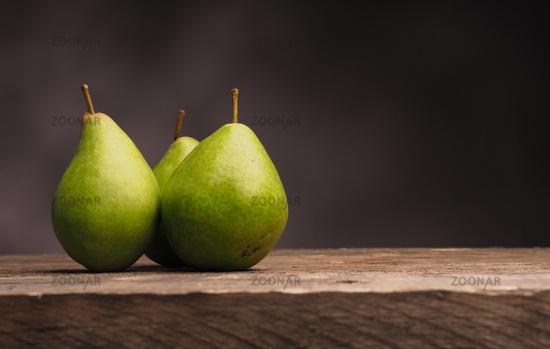 Three pears on wood