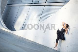 Attractive ballerina posing outdoors