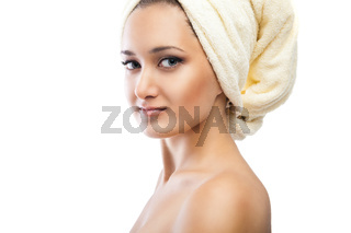Young beautiful woman wrapped in towel after bath