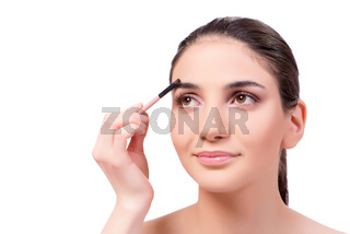 Beautiful woman during make-up cosmetics session