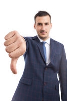 Focus on businessman hand showing thumb down