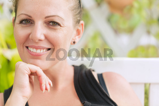 Portrait of young beautiful smiling woman