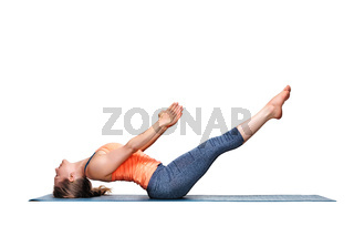 Sporty fit woman practices yoga asana Uttana padasana
