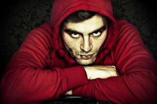 hip-hop man in red hood against black background