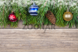 Christmas fir tree with toy on wooden background