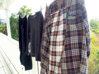Flannel Shirt and Sweaters Drying on Clothesline