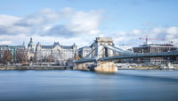 The Széchenyi Chain Bridge suspension bridge spans the River Danube between Buda and Pest, showing the Four Seasons Hotel Gresham Palace on the eastern sides of Budapest, the capital of Hungary.
