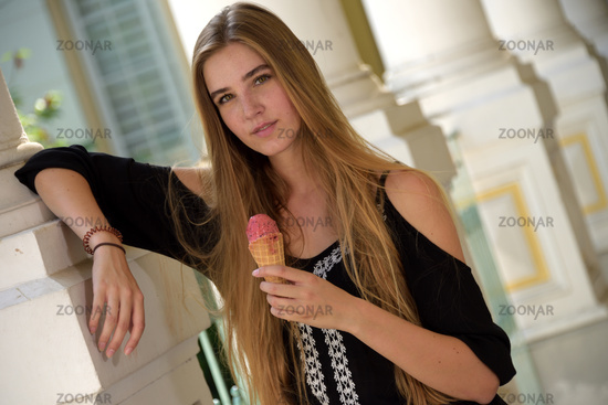 Young woman eating ice cream