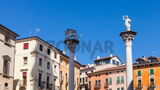 statues on tops of columns at Piazza dei Signori
