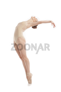 young modern ballet dancer jumping on white background