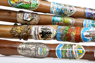 Walking sticks with many hiking badges