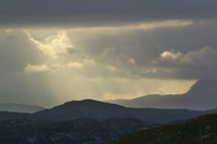 Rainclouds with sunray over the Scottish Highlands
