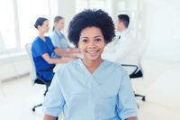 doctor or nurse over group of medics at hospital