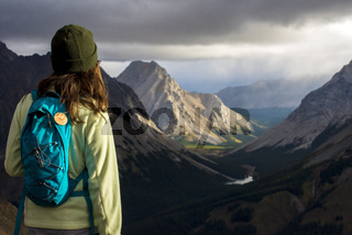 Brown haired girl looking out at mountains