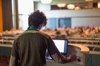 Public speaker giving talk at scientific conference.