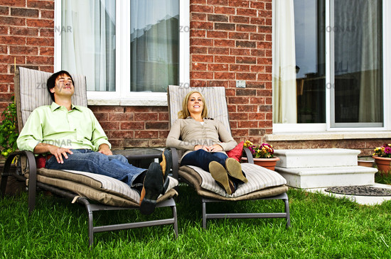 Happy couple relaxing at home
