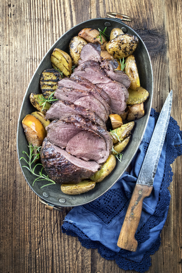 Roast Venison with Potatoes and Quince in Copper Pot