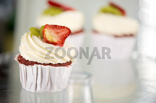 cupcake with cream and strawberry at sweet shop