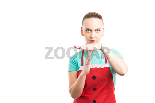 Tired housekeeper or maid showing time out gesture