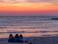 Three friends looking to the sunrise