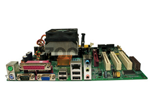 The motherboard of your computer. Close-up. Isolated on a white background.