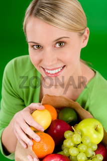 Healthy lifestyle - woman with fruit shopping paper bag