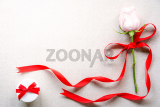 Rose with red ribbon and a cute gift box