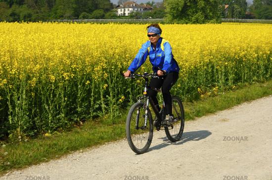 Bicyclist at rape field
