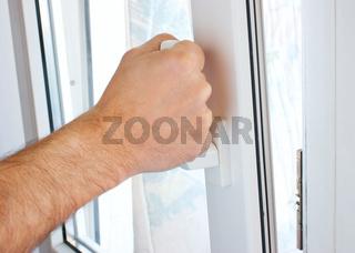 hand opens a window