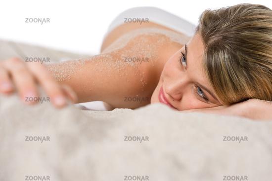Beach - woman sunbathing on sand