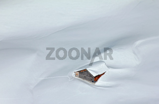 Snowed-in mountain hut in the Alps