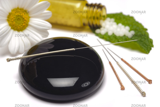 alternative medicine with herbal pills and acupuncture