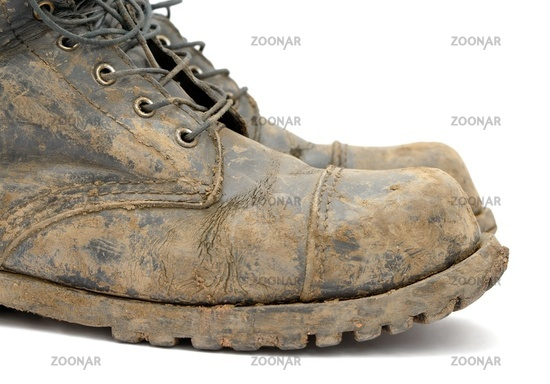 A pair of muddy boots