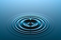 Water drop falling into water surface