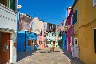 Colorful street in Burano, near Venice , Italy