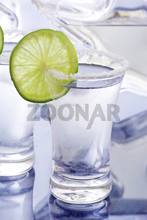 Hard liquor with ise and lime slice as closeup