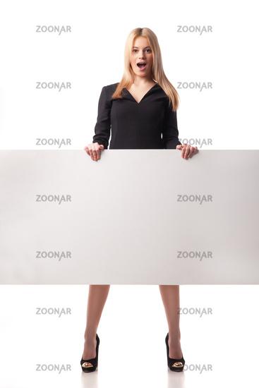 Surprised businesswoman holding placard