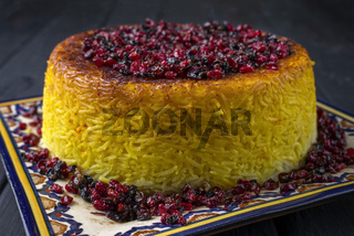 Traditional Iranian Rice Pie Tahdig with Berberis on a plate