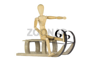 Wooden mannequin on a sleigh
