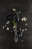mystic light blueberries on a dark background