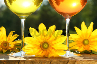 Golden wine in the sun on a rustic table