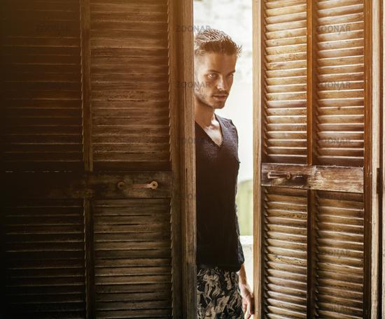 Handsome man walking in doors