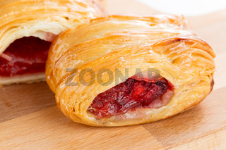 Puff pastry pies with cherry and honey.