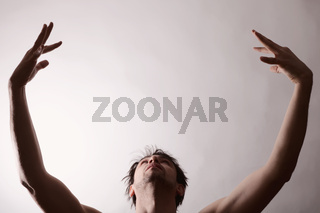 Portrait of Young man dancing on white background