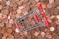 Euro cent coins and empty shopping cart