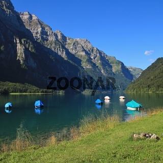 Beautiful landscape in the Swiss Alps. Lake Klontalersee and Glarnisch, mountain range. Travel destination in Switzerland.