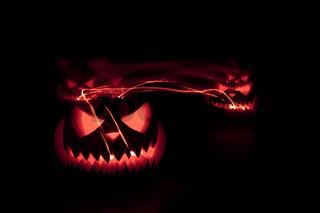 Halloween pumpkins shiny inside on black